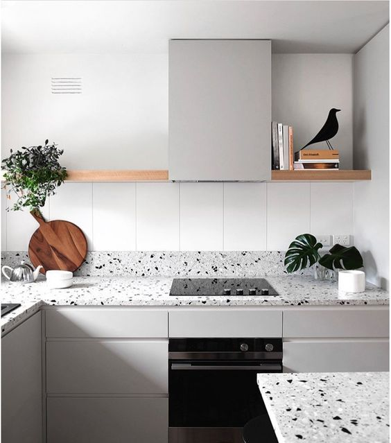 dove grey cabinets and light grey terrazzo with black and white spots