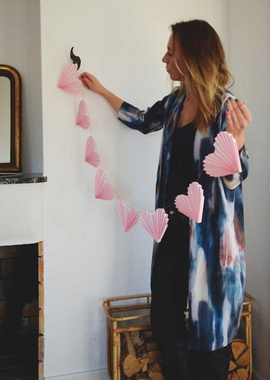 pink folded paper hearts attached to a thread is a simple and cute idea