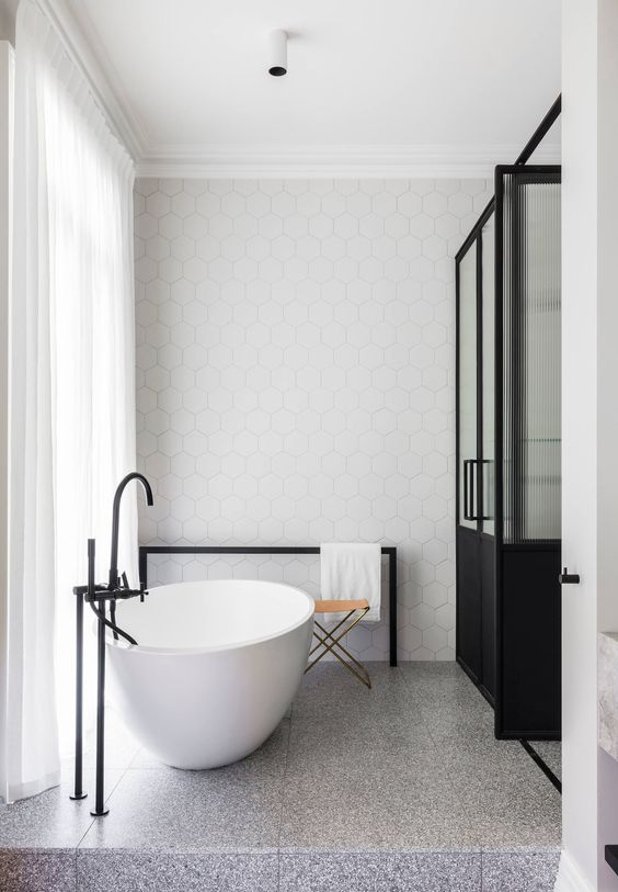 Grey And White Terrazzo Tiles On The Floor With Small Spots For A Stylish Minimalist Space