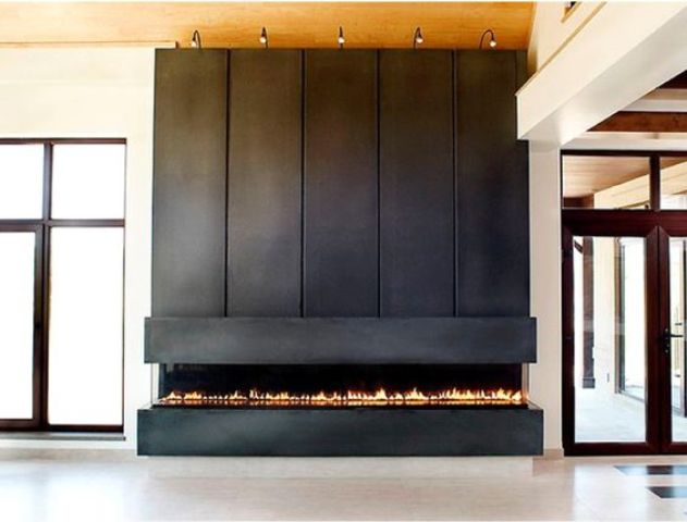 such a fireplace clad with narrow rolled steel panels looks very modern and eye-catchy