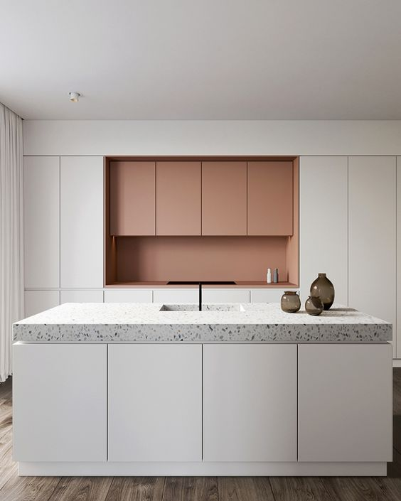 white and salmon pink cabinets and light grey terrazzo countertops
