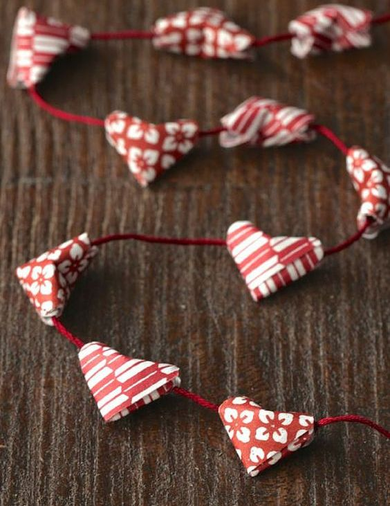 a very simple origami heart garland in red and white