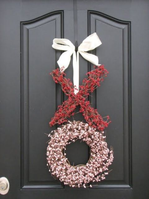 faux flower and berry branches in red and pink shaped as letters XO