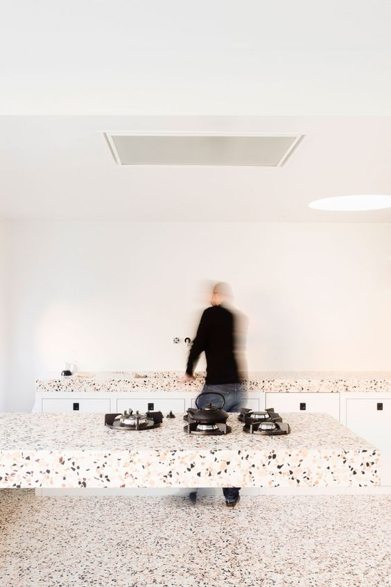 light-colored terrazzo countertops and a matching kitchen floor