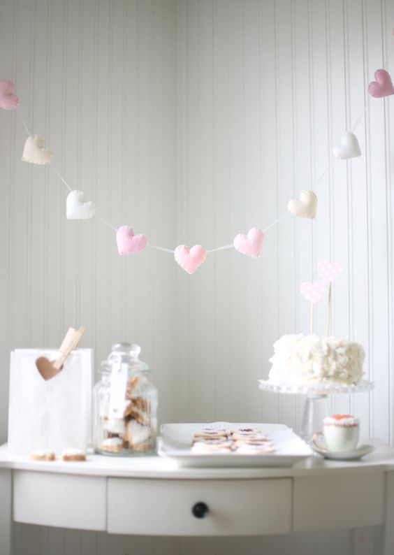 a cute sewn heart garland in the shades of pink for highlighting a dessert table