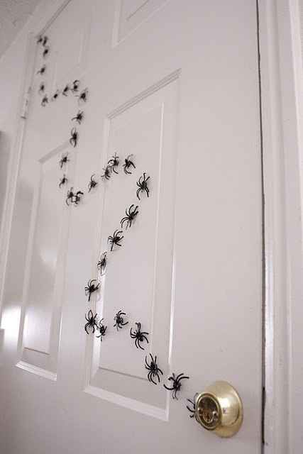 faux spiders attached to the door will remind of one of the films