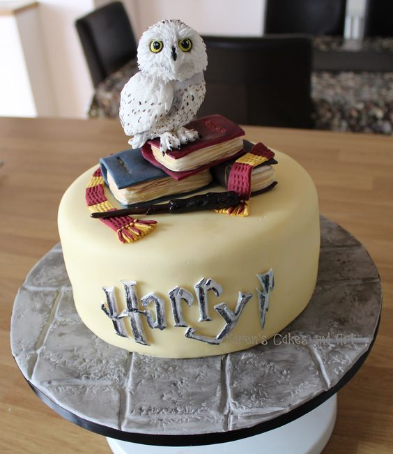 a cute Harry Potter birthday cake with books and a faux owl looks wow