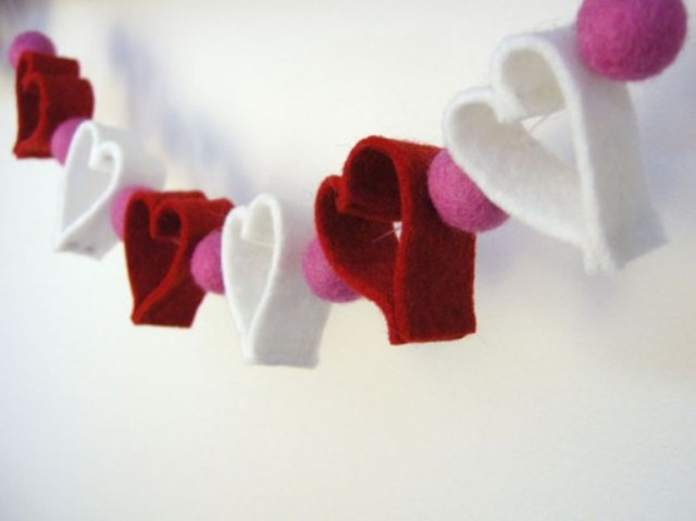 a cute felt heart and large pompom garland in red, white and pink