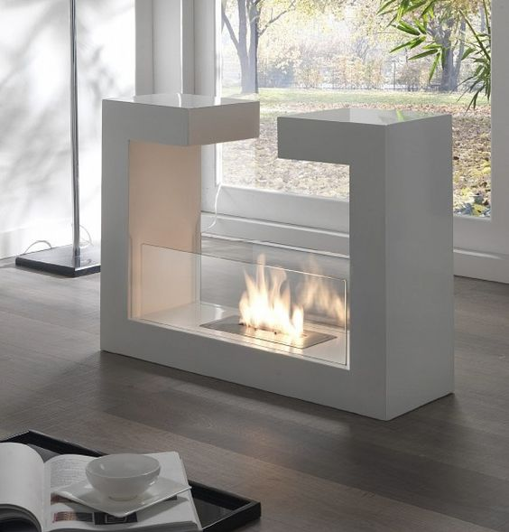a modern and sophisticated ethanol fireplace with glass covers can be moved wherver you want