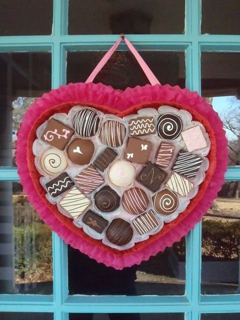 a pretty box of chocolate wreath using crepe paper, foam core and styrofoam balls