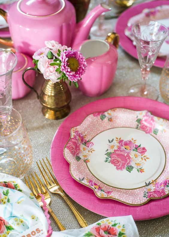 a vintage-inspired tablescape with bold pink touches and floral prints