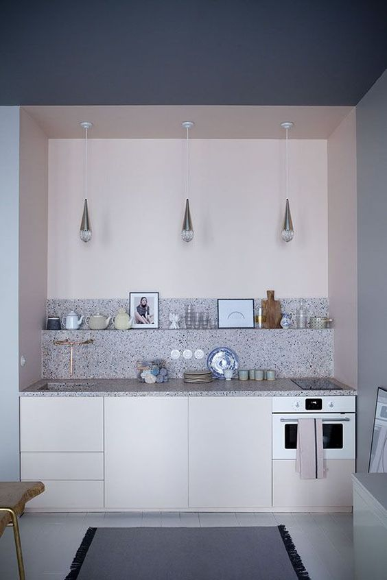 light pink cabinets and a grey spotted terrazzo backsplash