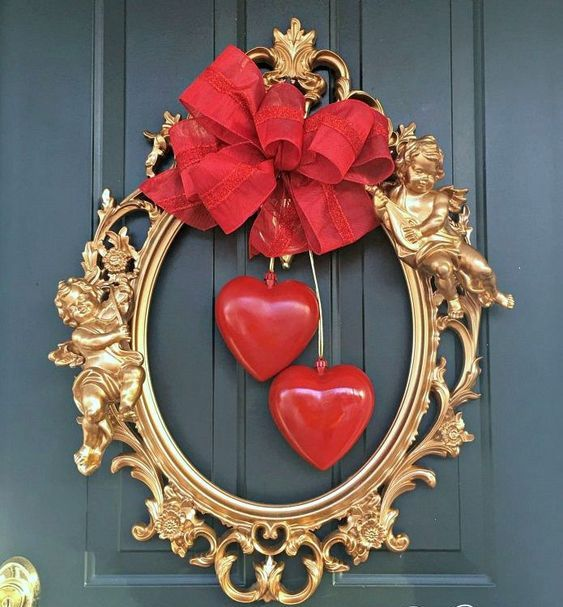 a refined gilded picture frame with red bows and hearts hanging is wow