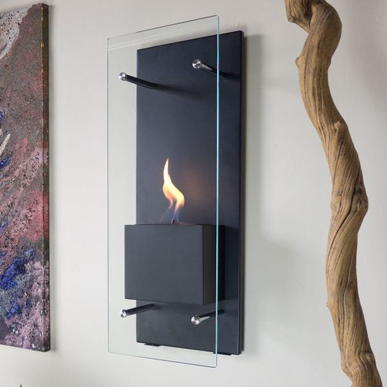 a wall-mounted bio ethanol fireplace is a nice idea for those who don't have much space