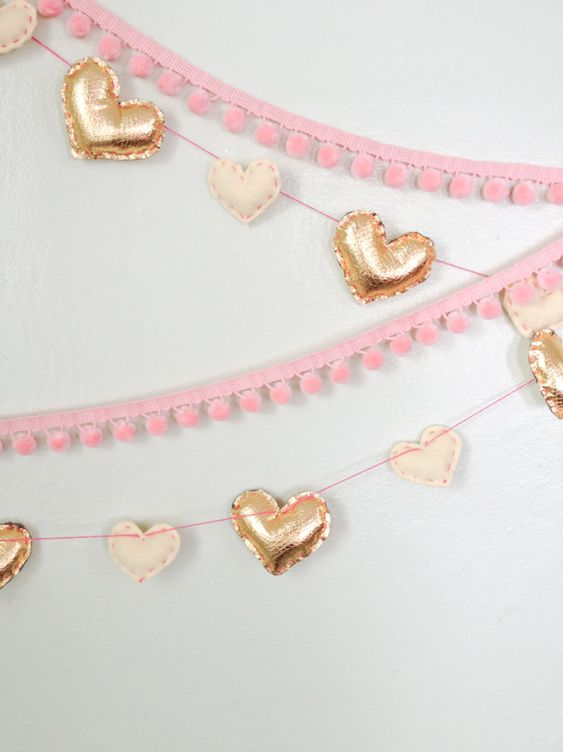 faux metallic leather and felt hearts to make garlands and pink pompom trim ones