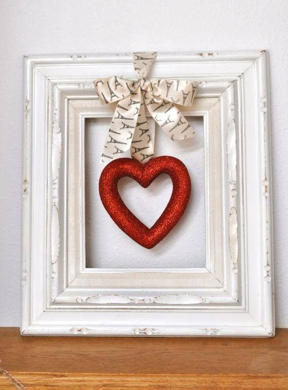 a vintage picture frame with a glitter hearts and a bow is easy to craft