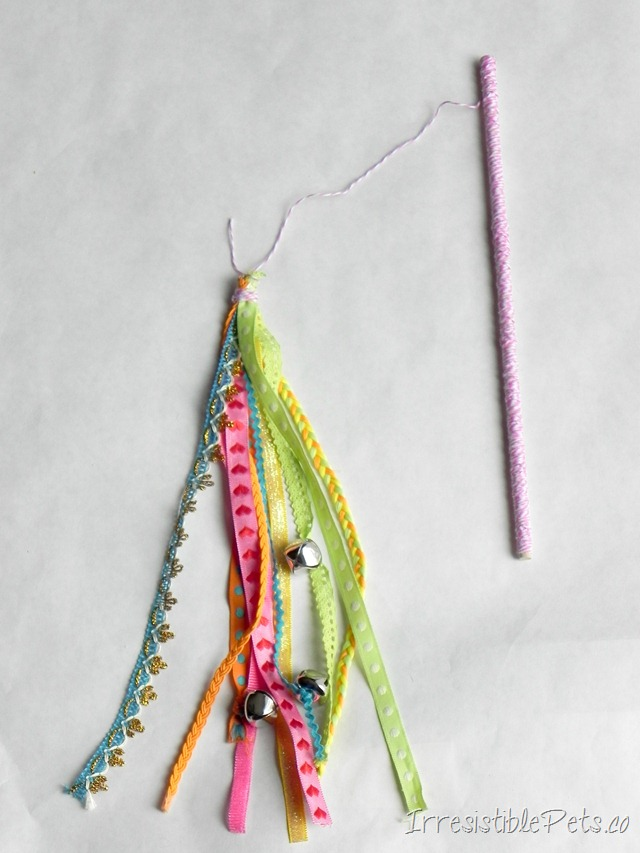 DIY cat wand with colorful ribbons (via irresistiblepets.net)