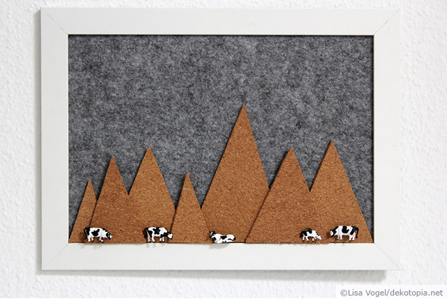 DIY felt pinboard with cork mountains and cow pins