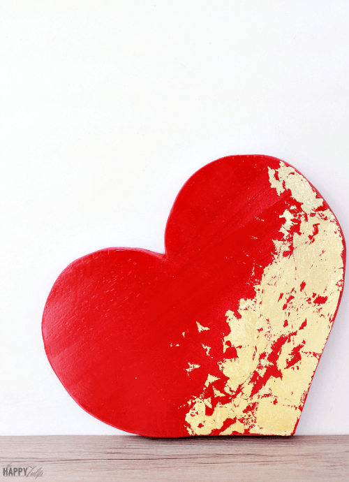DIY wooden heart with gold leaf decor (via www.shelterness.com)