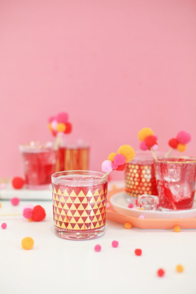 DIY colorful pompom drink stirrers (via lovelyindeed.com)