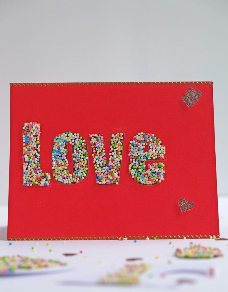 DIY red cardboard card with sprinkle covered LOVE (via www.elsarblog.com)