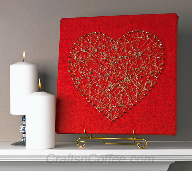 DIY red string art piece with glitter twine (via craftsncoffee.com)