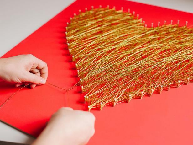 DIY bold red and gold thread string art piece (via www.hgtv.com)