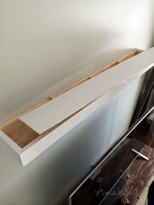DIY floating shelf with storage space inside (via www.shelterness.com)
