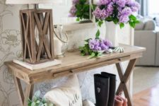 03 a console styled with fresh blooms and a basket with faux blooms and greenery for a farmhouse space