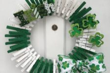 03 a green and white wreath of clothespins, with painted letters, glitter shamrocks and a printed bow
