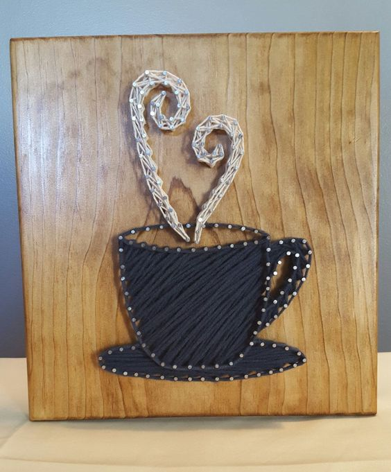 a stylish black and white coffee cup string art for fans of this drink