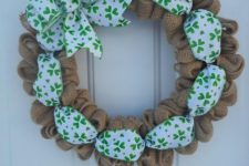 04 a burlap wreath with shamrock printed ribbon and a large bow looks very cute
