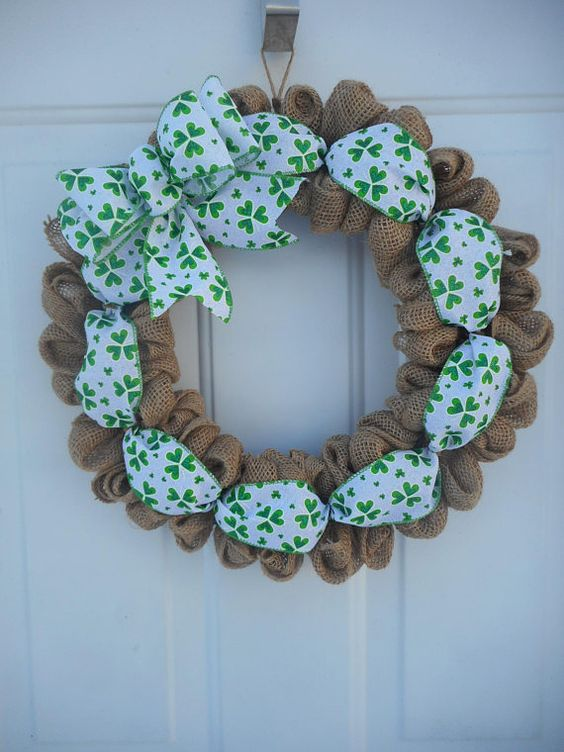 a burlap wreath with shamrock printed ribbon and a large bow looks very cute