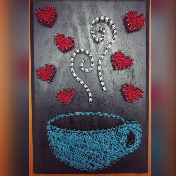a colorful string art piece with a blue cup of coffee and bold hearts for a cute look