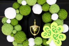05 a wreath of white and green yarn balls and a cardboard shamrock looks bold and creative