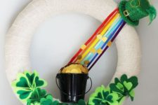 06 a white burlap wreath with fabric shamrocks, a rainbow and a bucket with gold coins
