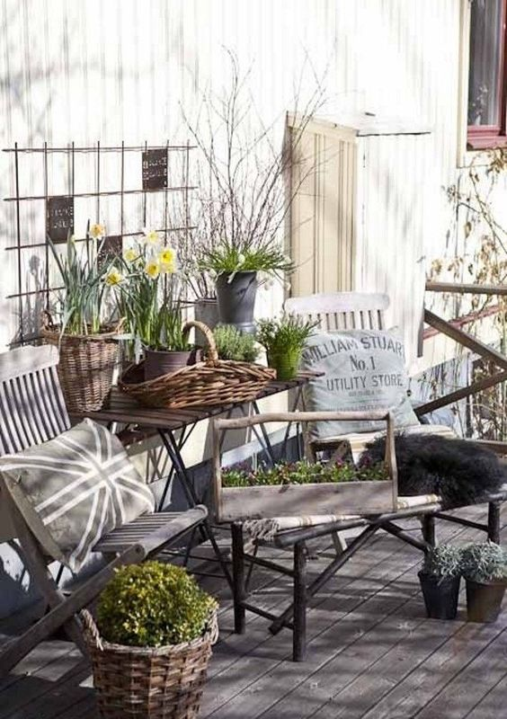 foldable chairs and a table look nice with baskets used as planters that bring a rustic feel