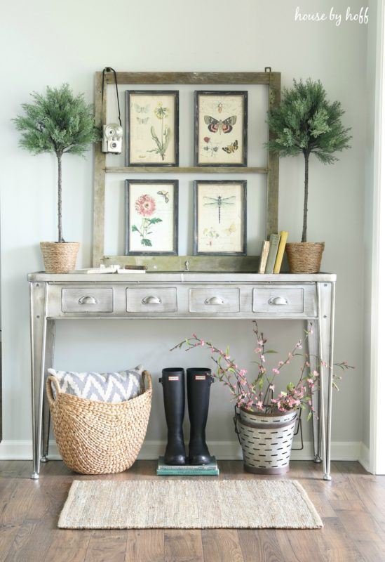 vintage flora and fauna posters and potted plants for styling a console for spring