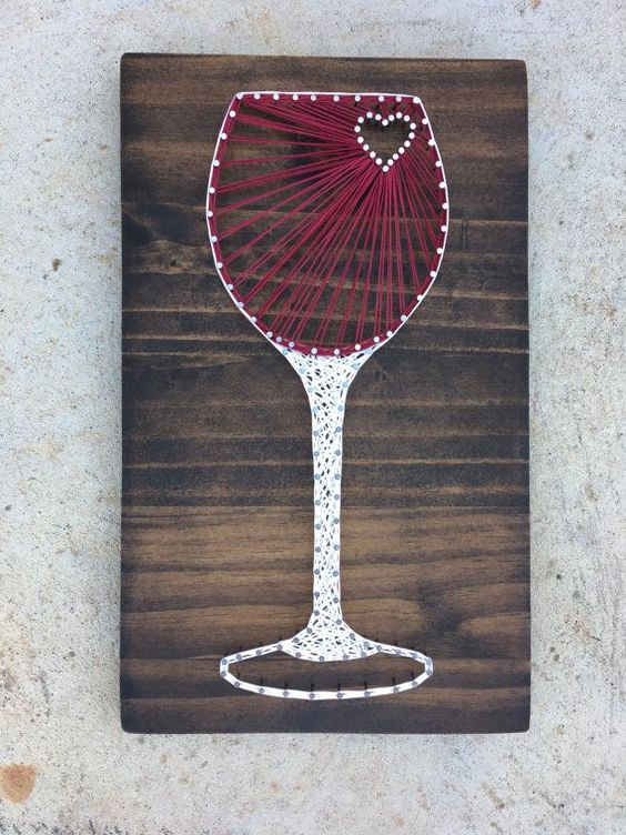 a chic wine glass string art in red and white with a heart is great for a girlish space