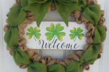 07 a usual and green burlap wreath with a large bow and a wooden plaque with shamrocks