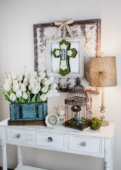 white tulips with willow in a box, moss touches and a bird cage with a faux biard and nest