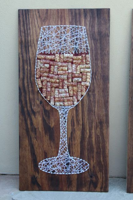 a cool wine glass string art sign with wine corks and strings
