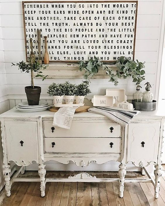 potted greenery and garlands for stylish an elegant farmhouse console table