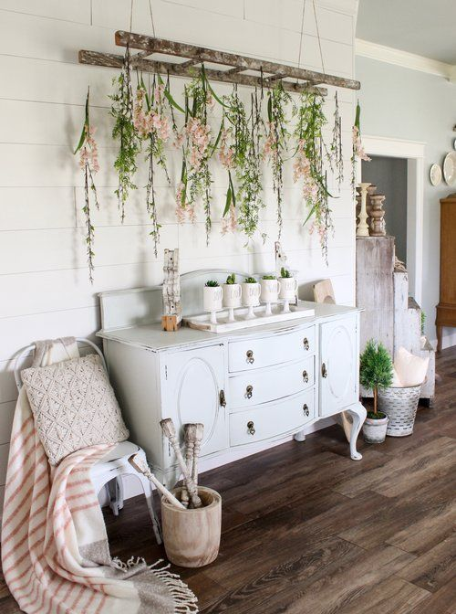 mugs with spring bulbs and an old ladder with blooms hanging down for a romantic feel