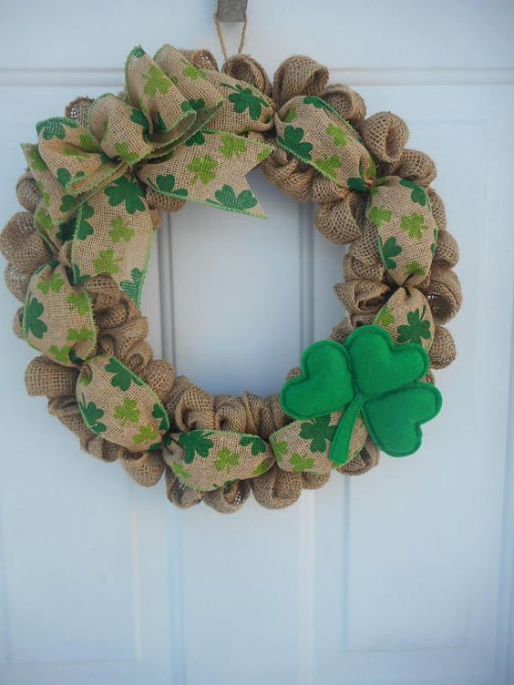 a burlap wreath with a felt shamrock and printed burlap ribbon