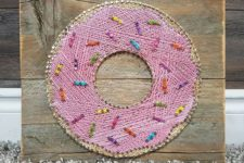 10 a fun and colorful pink donut string art with confetti decor