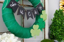11 a green burlap wreath with felt shamrocks and a chalkboard bunting