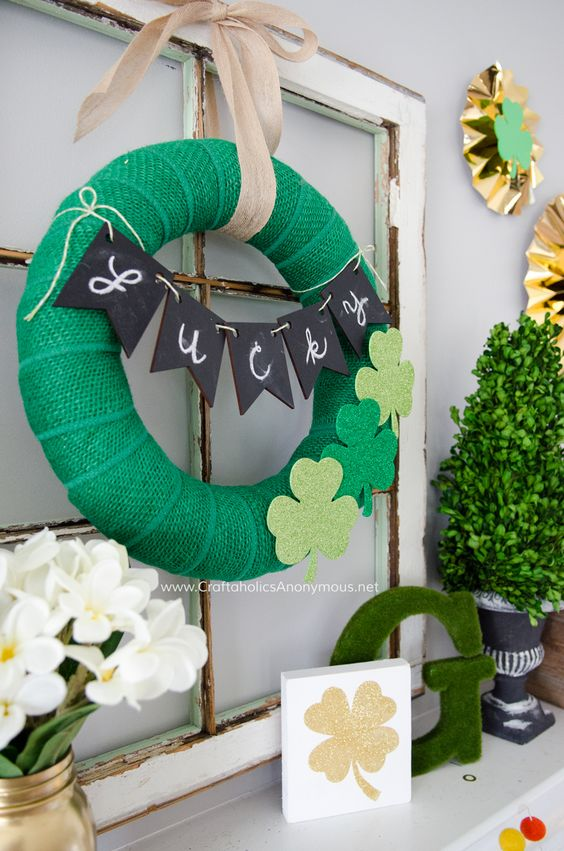 a green burlap wreath with felt shamrocks and a chalkboard bunting