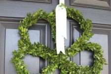 13 a cute boxwood shamrock decoration with white ribbon is an elegant and not tacky choice