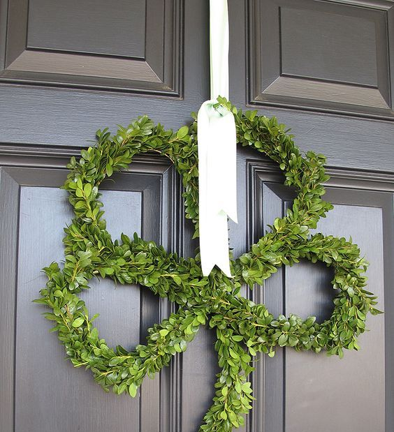 a cute boxwood shamrock decoration with white ribbon is an elegant and not tacky choice